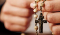 rosary-in-hands-close-up-small-300x179